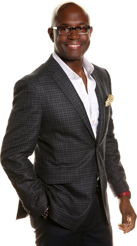 Bryan Williams posing in a suit